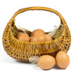 Brown Chicken Eggs and Pen in a Wicker Basket Isolated on White — Stock Photo #50859899