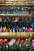A rack of colorful shirts hanged for sale at a fair — Stock Photo