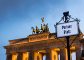 Brandenburg Gate in a cloudy sunset — Stock Photo