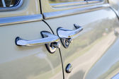 Handle of a white antique car — Stock Photo
