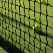 Tennis ball behind the net — Stock Photo #48324883