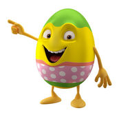 Smiling Easter egg pointing by hand — Stock Photo