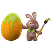 Easter bunny with egg and brush — Stock Photo