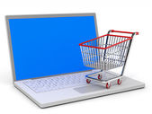 Shopping cart and laptop. — Stock Photo