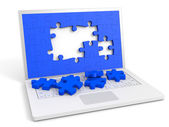 Laptop with puzzle pieces into the screen. — Foto Stock