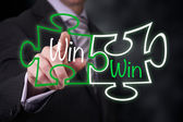 Businessman Pointing at a Win Win puzzle — Stock Photo