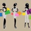 Silhouettes of women with shopping bags — Stock Vector #43296957