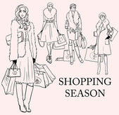 Stylish women with shopping bags — Stock Vector