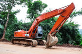 Heavy earth mover at construction site — Stock Photo