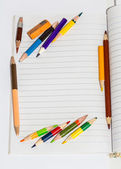Colour pencils on the book — Stock Photo