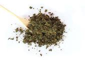 Tea dried leaves on the white background  — ストック写真