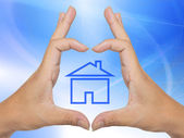 Conceptual home symbol made by hands — Foto Stock