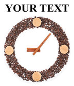 Clock from coffee beans, biscuits and cinnamon sticks — Stock Photo