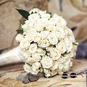 Wedding bouquet from roses, cuff links — Stock Photo