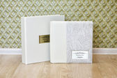 Wedding photo book with leather combined cover and metal shield. — Stock Photo