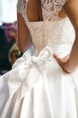 Beautiful wedding dress with bow at waist — Stock Photo