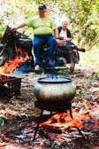 Cooking in pot on picnic — Foto Stock