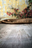 Wooden table with background — Stock Photo