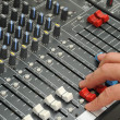 Постер, плакат: Hand of the sound producer and mixer console