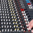 Hand of the sound producer and mixer console — Stock Photo