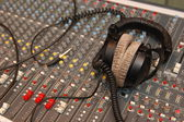 Sound mixing console with headphones — Stock Photo