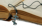 The book and a cross — Stock Photo