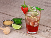 Strawberry mojito cocktail over wooden background — Stock Photo