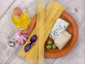 Raw pasta spaghetti and cheese — Stock Photo