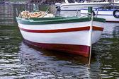 Boat moored in harbor — Stock Photo