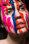 Girl with paint on her face — Stock Photo
