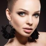 Beautiful woman with perfect skin and handmade jewelry — Stock Photo #47070557