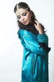 Beautiful girl in the Arab image with bright oriental make-up. — Stock Photo