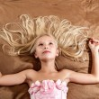 Beautiful little girl dreaming on bed — Stock Photo #43445223