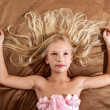 Beautiful little girl dreaming on bed — Stock Photo #43445225