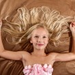 Beautiful little girl dreaming on bed — Stock Photo #43445287