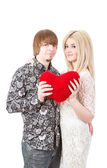Young love couple holding red valentine's heart  — Stock Photo