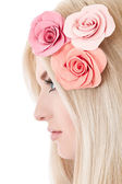 Beautiful young blonde woman with tender flowers in her hair — Stock Photo