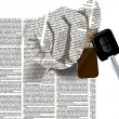 Постер, плакат: Hand newspaper columns texture with a car keys
