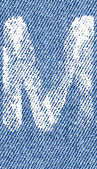 Vector letters and numbers on denim M — Vector de stock