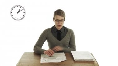 Woman seated at a table and doing a job — Stock Video