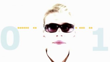 Woman wearing sunglasses in front of a digital animated background — Stock Video