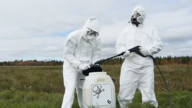 Two men in protective workwear with dangerous chemical — Stock Video