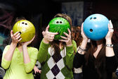 Girls play bowling — Stock Photo