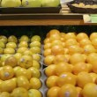 Tracking (dolly) shot moving past fruit in a supermarket grocery — Stock Video