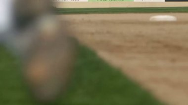 A team of baseball players run across the field toward the dugout in slow motion — Stock Video