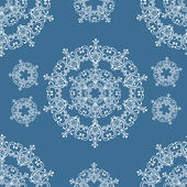 Seamless winter pattern with snowflakes. — Stock Vector