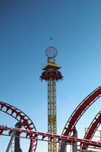 Amusement park  - rollercoaster in motion — Stock Photo