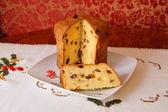 Christmas italian fruit-cake panettone partially sliced - 2. — Stock Photo