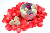 Water with jusmine and roses corolla in bowl and soft-prepared chalk for Songkran festival, Thailand — Stock Photo