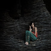 Beautiful girl in a mysterious place — Stock Photo